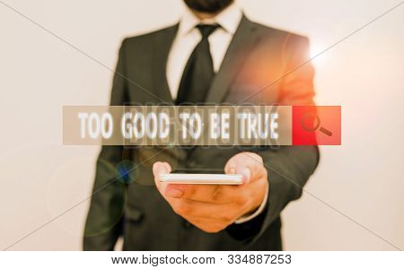 Word writing text Too Good To Be True. Business concept for Extraordinarily Fantastic but Doubtful Unthinkable Male human wear formal work suit hold smart hi tech smartphone use one hand. stock photo