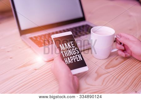 Writing note showing Make Things Happen. Business photo showcasing Exert Effort to Achieve and Fulfill something Go and Act woman with laptop smartphone and office supplies technology. stock photo