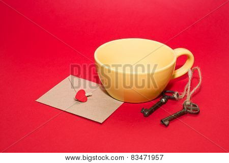 Key Mailing Envelope with heart is in the yellow cup on a red background. stock photo