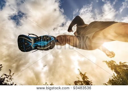 Outdoor cross-country running low angle view under runner concept for exercising, fitness and health