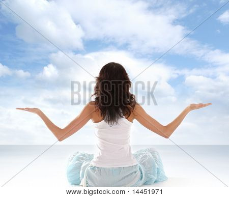 Young fit brunette meditating isolated on white stock photo