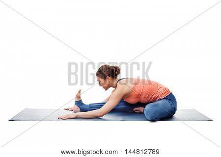 Young beautiful sporty fit woman doing Ashtanga Vinyasa Yoga asana Janu sirsasana A - head-to-knee pose A easy posture variation isolated on white stock photo