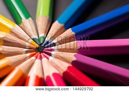 Color pencils in arrange in color wheel. Assortment of colored pencils.