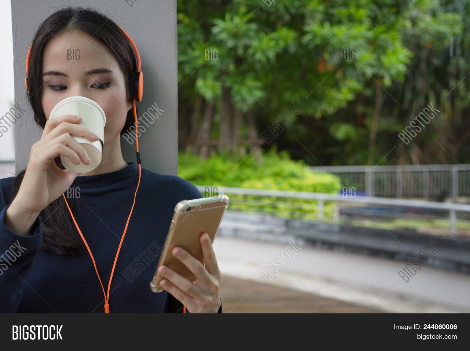 Woman Drinking Coffee Listening Music With Smartphone Headset Happy Beautiful Girl Relax With Coffe 244060006 Image Stock Photo
