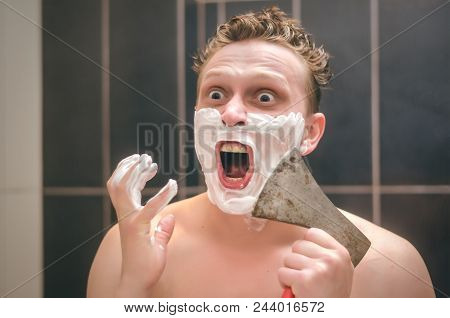 Man in shock after shaving with ax blade. Effective shaving concept. stock photo