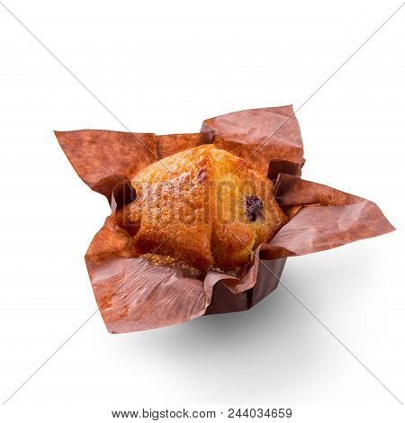 Delicious muffin on white background. Fresh cakes in decorative paper. Copy space to place text, close up stock photo