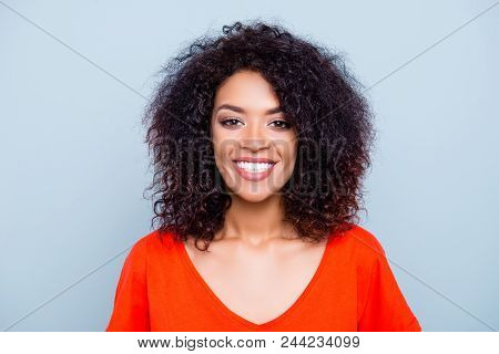 Portrait of cheerful joyful woman in orange outfit with white smile plump lips looking at camera isolated on grey background. Treatment therapy toothache ache problem concept stock photo