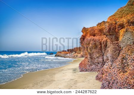 Arabian sea in Kerala. Picturesque cliffs, beaches and palm groves promises an unforgettable holiday. Malabar Coast stock photo