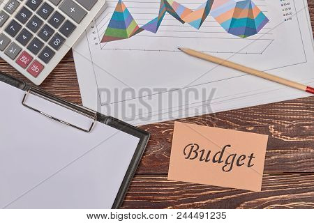 Attributes for finance and acoount. Top view, flat lay. Wooden desk background. stock photo