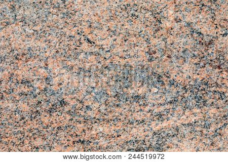 Granite, basalt or marble stone crystal texture of polished gravestone. The macro shot is made by means of stacking technology stock photo