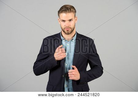 Formal menswear concept. Man bearded strict face wears formal clothes, grey background. Man with beard unshaven guy looks handsome and well groomed businessman. Guy bearded attractive with hairstyle. stock photo