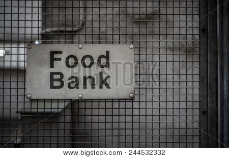 A Grungy Sign For A Food Bank In A Backstreet stock photo