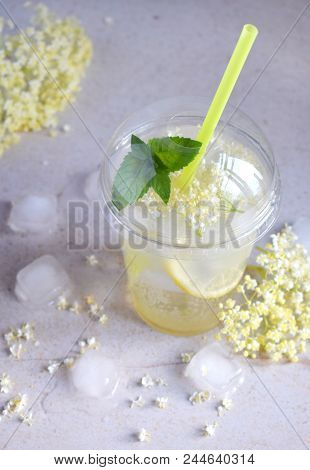 Elderflower blossom flower in wooden background. Edible elderberry flowers add flavour and aroma to drink and dessert. stock photo