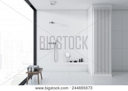 White tile bathroom interior with a white tile floor, a panoramic window and a shower. Concept of a cozy home. 3d rendering mock up stock photo