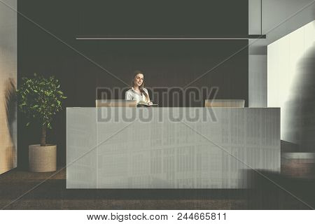 Businesswoman near a white office reception table with two computers standing in a company lounge with a black wall and a potted tree in the corner. 3d rendering mock up toned image double exposure stock photo