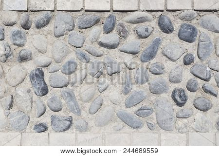background and texture of granite stone wall surface. Close up of a natural stone carpet. Decorative stone coating. Slip resistant floor finish containing natural stone particles stock photo
