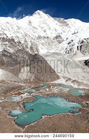 Beautiful panoramic view of Mount Cho Oyu and Cho Oyu base camp, Gyazumba glacier - Sagarmatha national park, Khumbu valley, Nepal Himalayas mountains stock photo