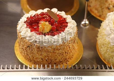 Fancy Cake With Strawberries and Red Currants stock photo
