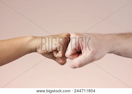 Two fists bumping each other. Fight or deal concept. Teamwork and strength of two people. Hands bumping fists. stock photo