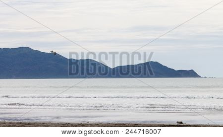 Landscape image of Kapiti Island, on the lower west coast of New Zealand, in the late afternoon stock photo