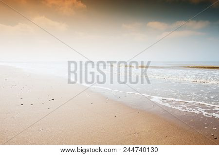 Sandy beach at sunset. Beautiful nature background stock photo