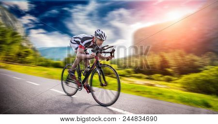 Cyclist rides on bicycle, speed effect, side view stock photo