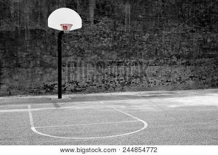 Detail of urban basketball hoop inner city innercity wall and asphalt in outdoor park stock photo