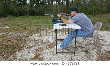 Man sighting in his rifle at a local rifle range, getting ready for the upcoming hunting season stock photo