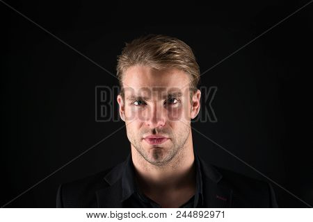 Confidence and masculinity. Man well groomed with bristle and hairstyle black background. Macho confident strict face close up. Guy handsome attractive formal wear. Guy confident in his appearance. stock photo