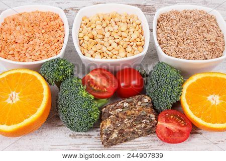 Nutritious products containing vitamin B9, natural sources of minerals and folic acid, concept of healthy nutrition stock photo