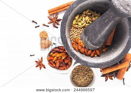 Mix of spices for homemade Tandoori masala in mortar on white background stock photo