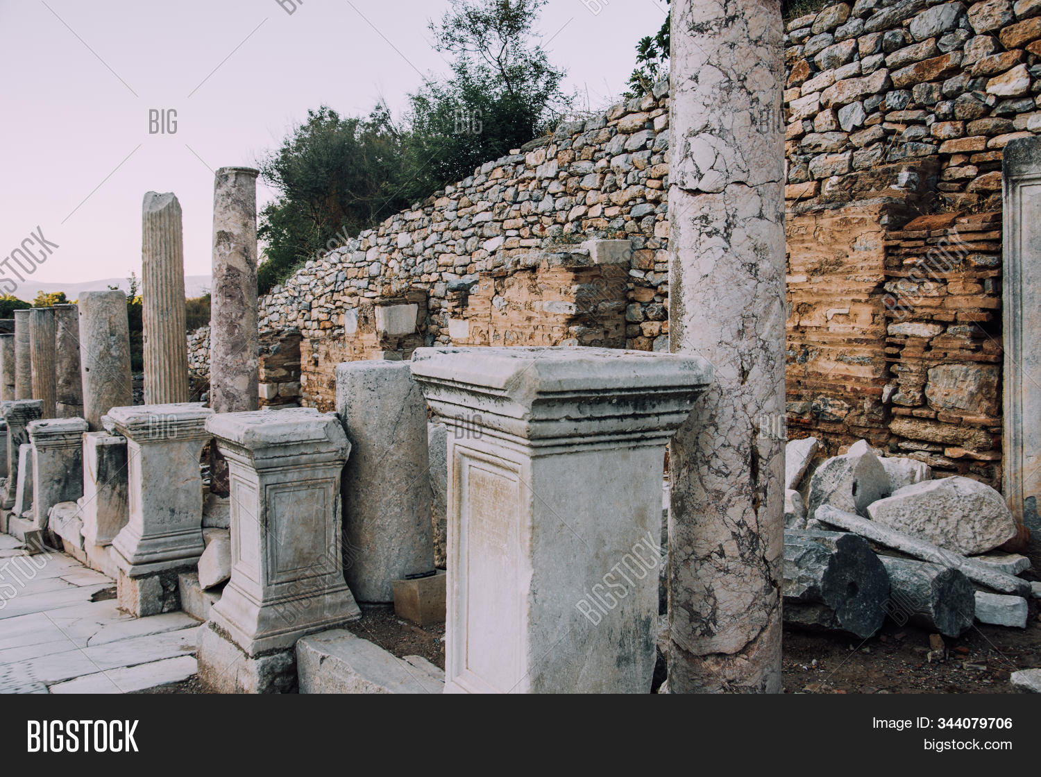 Antique city of Ephesus.Ruins of an ancient city in Turkey.Selcuk, Kusadasi,Turkey.Archaeological site,expedition.Remains of an abandoned ancient Greek city.Antique statues and columns.Place for text.