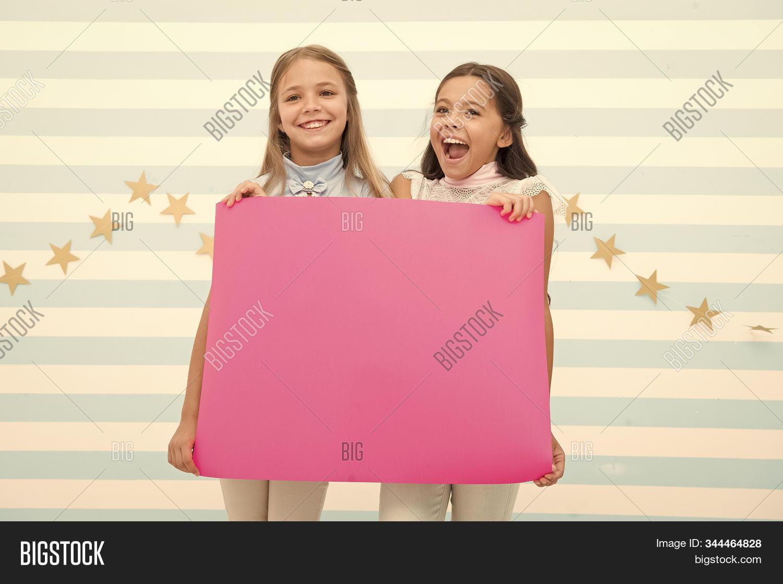 Congratulations concept. Amazing news. Girls hold congratulations banner. Kids holding banner for announcement. Children happy blank paper greetings copy space. Happy holidays. Congratulations to you.