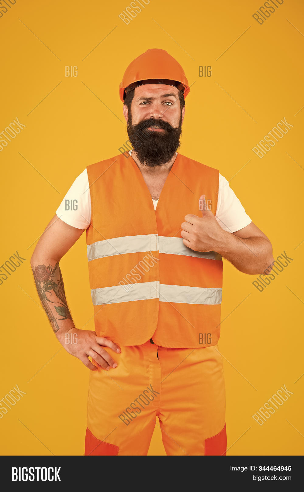 confident,man,worker,happy,gesture,confidence,positive,cool,optimistic,hopeful,sure,certain,work,working,builder,contractor,constructor,repairs,repairing,renovations,uniform,protective,protection,hat,helmet,vest,workwear,profession,professional,industrial,industry,gesturing,hipster,beard,unshaven,mustache,brutal,caucasian,moustache,smile,smiling,emotions,yellow,background