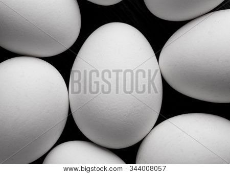 Background of white chicken eggs. Chicken eggs top view. White chicken eggs close-up. A bunch of white raw eggs. stock photo