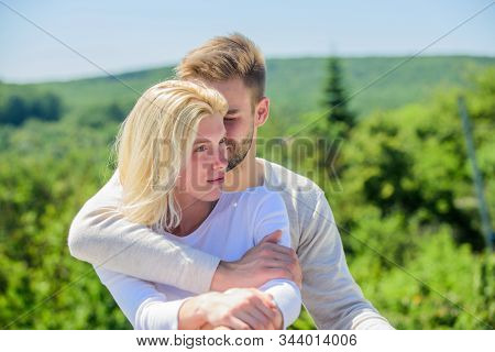 True love. Tenderness concept. Enjoy every moment. Peaceful romantic people. Enjoyment. Summer romance. Family love. Love story. Romantic relations. Couple in love. Man and woman sunny day outdoors stock photo