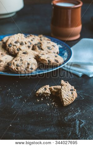 Baked broken cookie and crumbs still life stock photo