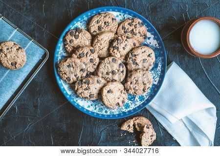 Still life of baked cookies on a black chalk board stock photo