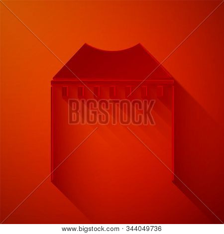 Paper cut Camping tent icon isolated on red background. Carnival camping tent. Amusement park. Paper art style. Vector Illustration stock photo