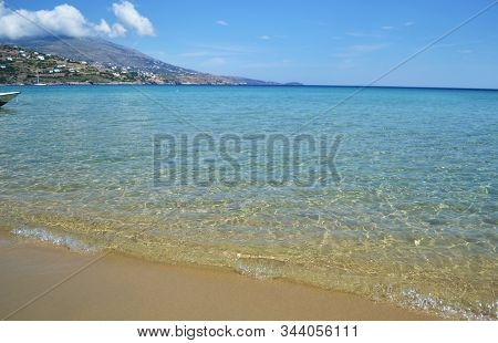 scenery of turquoise Aegean sea at Andros island Cyclades Greece stock photo