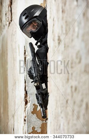 Anti-terrorist police soldier armed with assault riflel ready to attack stock photo