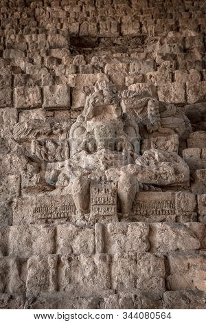 A Mayan figure on the stairs of the Copan Ruinas temples. Honduras stock photo