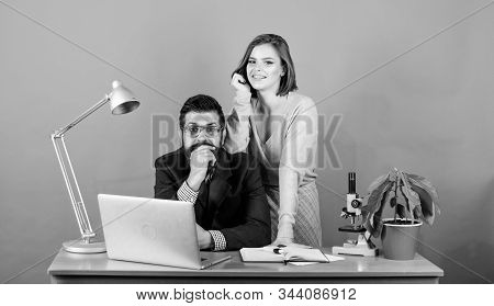 love affair at work. Seduction. businessman and assistant solve problem. woman and man work in office at laptop. business couple at computer. secretary with boss at workplace. Business conference stock photo