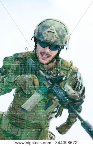 modern warfare american marines soldier in action while sneaking and aiming  on laseer sight optics  in combat position and  searching for target in battle stock photo