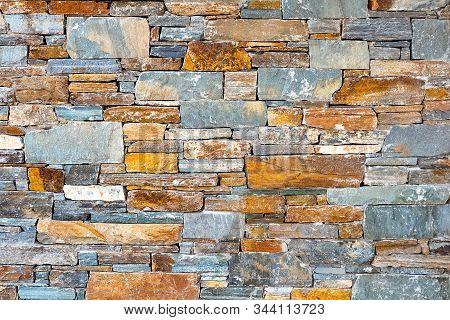 Stone brick wall pattern texture background. Asymmetrical wall of modern architecture. Background of stone wall. Texture of old brick. Modern architecture. Old wall made of the Jerusalem stone stock photo