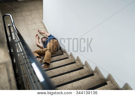 Unconscious Man Lying On Staircase After Slip And Fall Accident stock photo