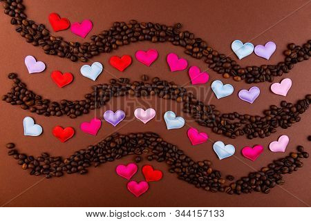 Vaughn of coffee beans and hearts on a dark background. stock photo