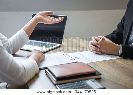 Employer or recruiter holding reading a resume with talking during about his profile of candidate, employer in suit is conducting a job interview, manager resource employment and recruitment concept. stock photo