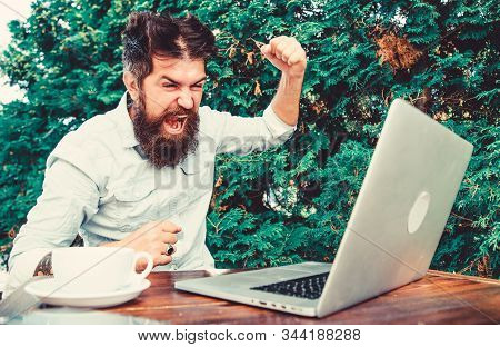 brutal bearded hipster need coffee break. stressed man working on laptop. Frustrated office worker. aggressive businessman. agile business. solve problem. deadline. a lot of work. Work hard play hard stock photo