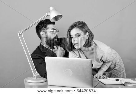 love affair at work. Seduction. business couple at computer. businessman and assistant solve problem. woman and man work in office at laptop. secretary with boss at workplace. Young professional team stock photo